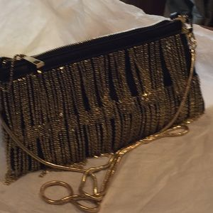 Swinging chains formal bag